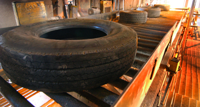 Tire Conveyor Headed for the Chute
